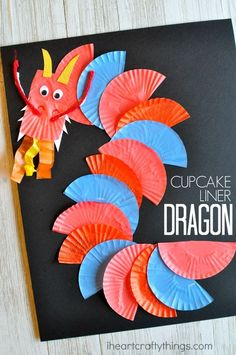 This cupcake liner dragon craft makes a great Chinese New Year craft for kids. You could also use it as an alphabet craft for the letter D. #MulticulturalArtsandCrafts