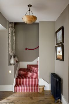 The plush stair runner is from Sinclair Till (sinclairtill.co.uk). The antique ceiling light is from Hector Finch (hectorfinch.com). The cord hand rail is from The Period Rope & Rail Co (stairropes.co.uk). The walls are painted in Farrow & Ball's Mouse's Back (farrow-ball.com)