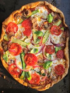 "Veggie Pizza Recipe | By: Dr. Charlotte Brown  Dr. Travis Stork | ""Pizza is an easy way to sneak in veggies, and the summer is an especially great time to make it since there are so many fresh choices! I pretty much just empty out the crisper and add everything we have, but you can pick and choose your favorite toppings."" 