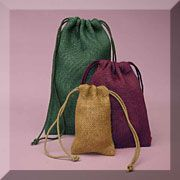Colored Burlap Fabric Bags  Wish I would've seen this earlier... Ah well, perhaps I'll find a need for it some other time...