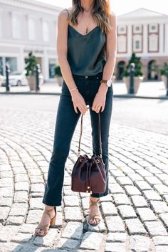 Jess Ann Kirby styles the perfect transitional crossbody bag from Brahmin with Paige jeans and a silk tank