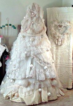 """Wedding Gown Tree - Quote the blogger: """"I collect vintage wedding gowns and I used 10 of them to make this tree.  Don't worry...none of them were harmed in the making of the tree!""""  (from Penny's Vintage Home blog)"""