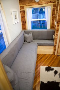 Love the corner couch for a tiny house, you could totally entertain!