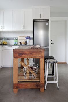 In Jillian Harris' kitchen, a wooden island becomes even more versatile with the addition of a couple of stools. Home, Home Kitchens, Portable Kitchen, Kitchen Design, Kitchen Decor, Portable Kitchen Island, Celebrity Kitchens, Eclectic Kitchen, Celebrity Houses