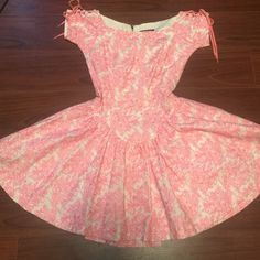 """Vintage Betsey Johnson Full Circle Evening Dress Vintage Betsey Johnson White and Pink Embroidered Evening Full Circle Dress. Corset, Lace Up Shoulder Sleeves, Full Zipper w/ Eyelet Closure. Full Lined. Dress is in perfect, flawless condition!! Size 2. Measurements: Length 31"""" and Waist 13.5"""" Betsey Johnson Dresses"""