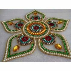 Moti & green flower 250Rs 5 outer &2 middle pieces Material :Ohp sheet & kundan