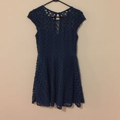 """Green/blue lace dress Dark greenish blue lace dress. Cap sleeves. Sweetheart neckline under lace top. No rips or tears but I cut the tag out because it showed through the back lace so I don't remember what the brand was. Hits about mid thigh (I'm 5'3"""") no stains. Dresses Mini"""