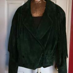 Vintage FRINGE IS IN!! GREEN SUEDE JACKETS Suede ..fringes .. waist length.. fringes on front of coat and on the side of the sleeves..silver buttons at lower front..VERY detailed...this is a classic that will never go out of style the brand is G4000.. great designer..see google on who this designer is! No flaws or scratches..TOP condition..I had it stored properly Jackets & Coats
