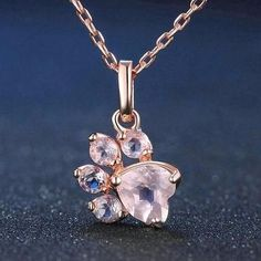Cameow™ Paw Rose Quartz Necklace $29.00   #meow #cats #cutecat #kitties #kitten #mainecoon #kittens #catlover #kitty #cat Adjustable - ONE SIZE fits mostMain stone design with paw and heart shaped natural rose quartzMetals Type is 100% real 925 Sterling Silver! Carefully selected and perfectly matched set of a 5 x 5Heart shaped 18K with a rose gold plated quartz!