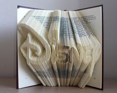 An old book was used to display the word Disney.    Each page is carefully folded in a specific way so something amazing is popping out of the