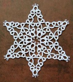 The designer is Myra Piper. From her Tatting Book, page 13, pattern No. 36.