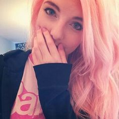 Hello earthlings! I'm Lizzie also known as LDShadowLady. I'm 22 and I make Minecraft videos on my Youtube channel, along with Call of Duty and gmod. I have a boyfriend called Joel (aka SmallishBeans). I love cute and colourful things, I have a cat called Buddy, and I live in England!