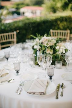 beautiful wedding table set-up at a hotel in provence white green floral