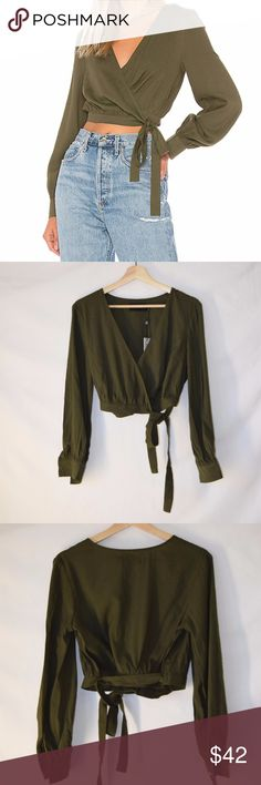 NWT MINKPINK Wrap Blouse Khaki Long Sleeves New with tag MINKPINK  55% viscose , 45% poly Wrap design with tie closure Buttoned sleeves Long Sleeves Color Khaki No care label MINKPINK Tops Blouses
