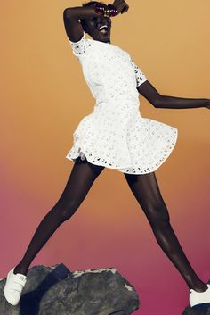 Julia Noni - Gradient background with black model wearing white clean simple dress.