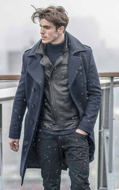 Consider wearing a black leather moto jacket and black jeans to get a laid-back yet stylish look.  Shop this look for $161:  http://lookastic.com/men/looks/navy-turtleneck-black-biker-jacket-navy-overcoat-black-jeans/4267  — Navy Turtleneck  — Black Leather Biker Jacket  — Navy Overcoat  — Black Jeans