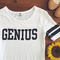 """Old Navy """"Genius"""" Tee Old Navy """"Genius"""" Tee -Fun casual tee, two stripes on 1/4 length sleeves. -60% Cotton, 40% Modal. Machine wash. -Worn sparingly. :inna_lala Old Navy Tops Tees - Short Sleeve"""