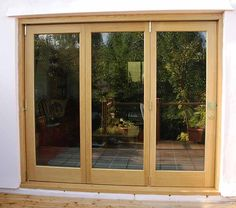 A great natural look Timber Bifold doors can provide.