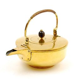 Brass kettle cover with ebony knob design execution by Jan Eisenloeffel ca.1903 for de Woning Amsterdam / the Netherlands