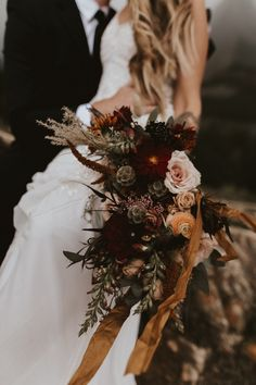 Many Glacier vow renewal in the Mountains Stormy bride and Groom Moody and windy Fall inspired moody bouquet Bridal Bouquet Fall, Fall Wedding Flowers, Fall Wedding Colors, Bridal Flowers, Flower Bouquet Wedding, Floral Wedding, Autumn Wedding Decorations, Wedding Ideas, Wedding Poses