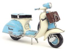 Retro Style 1965 Blue and White Vespa Motorcycle by SimpleSmart