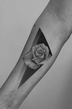 Dotwork rose on the inner forearm.