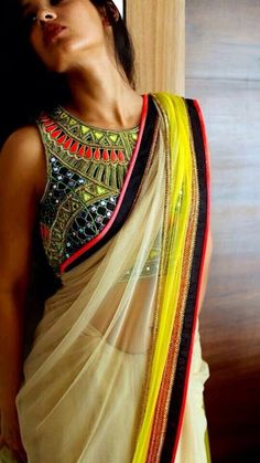 I love this blouse, but maybe different color sari instead of creme. #indianfashion #fashionindia More