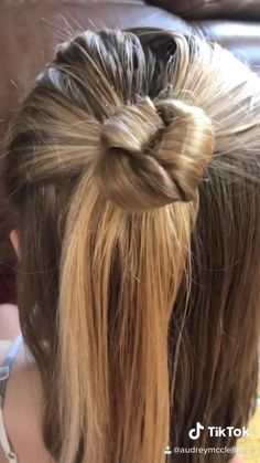 Easy Knotted Bun - here's a super cute updo. Anyone can pull this hairstyle off. Love this easy hairstyle. style easy style for girls style for school style long style simple Medium Length Hairstyles, Easy Hairstyles For Long Hair, Cool Hairstyles, Wedding Hairstyles, Ponytail Hairstyles, French Braided Hairstyles, Hairstyles With Scarves, Pirate Hairstyles, Scrunchy Hairstyles