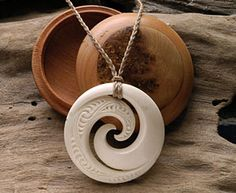 Maori Koru necklace carving made from deer antler.   www.boneart.co.nz