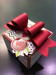 Kraft gift box decorated with Season of Style chevron DSP and accented with paper bow.