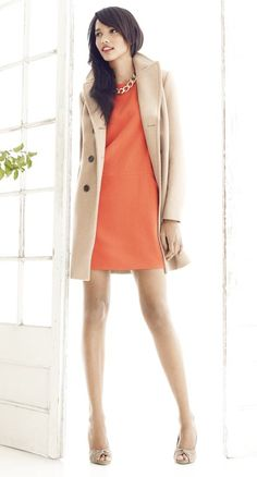 tangerine shift dress with camel coat and nude heels