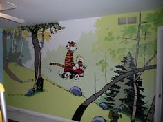 Maybe a mural is a bit overboard, but I love the idea of Calvin & Hobbes for a little boy's room theme.