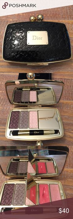 Dior Compact. Three beautiful Eyeshadows and two lips glosses. The one lip gloss had a gash in it from the brush hitting it. It was not used. The other was only touched lightly. The shadows are unused. Dior Makeup Eyeshadow