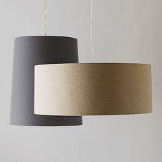 New at West Elm: subtly glamorous natural linen drum pendant lights, with a cotton-fabric-covered diffuser that filters the light.