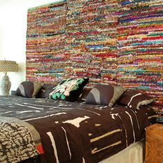 Turn rag rugs made from torn saris into a boho chic headboard.