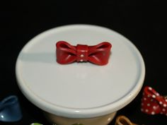 """1 1/2"""" red bow with two rhinestones."""