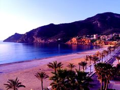 Albir beach, Alfaz del Pi, Alicante, Spain. This was my beach, and the village.  The house I lived in was somewhere up in those cliffs.
