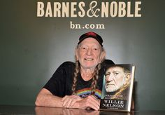 """Willie Nelson Photos Photos - Willie Nelson signs copies of his book """"It's A Long Story: My Life"""" at Barnes & Noble Union Square on May 7, 2015 in New York City. - Willie Nelson Signs Copies Of His Book 'It's A Long Story: My Life'"""