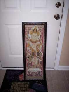 Framed fabric with the traditional batik patterns purchased in Myanmar 1999