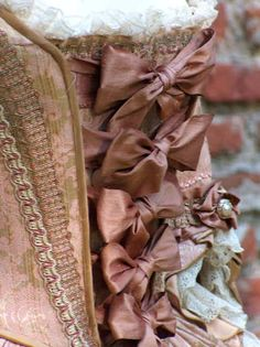 Rococo detail - bows, frills and lace.. highly flamboyant is what the Rococo is all about