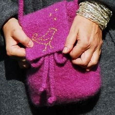 "When it comes to my addiction to all things textilicious… my love of felted bags is second only to scarves! I cringe when I admit… I stopped counting my ""felted friends"" years ago.The idea for this little day caddy came to me in line for coffee. The cavernous tote I had grabbed that morning--- yes, felted--- refused to surrender my wallet! Well, my lovelies, the Mother of Invention is a knitter!     This pouch is a perfect fit for my simple daily needs: wallet, keys, glasses, lipstick, iPod."