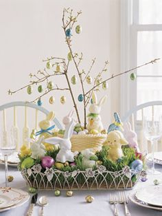 How-to: Push branches into foam inside a white-chocolate basket and hang eggs by a thread looped through the foil. Elevate basket and surround with grass and Easter treats.  - GoodHousekeeping.com