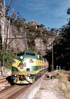 CLP14E and CLP16W on down Indian Pacific emerge from number 8 tunnel near Zig Zag on December 9th, 1996