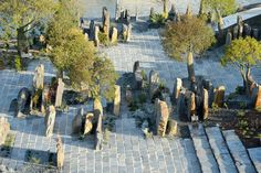 """Taylor Cullity Lethlean, Paul Thompson — Australian Garden. upright stones add different texture to the space and serves as a """"middle layer"""" of interest below the trees."""