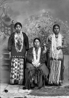 suchasensualdestroyer:    Portrait of unknown women (Ho-Chunk? Wisconsin?) in ribbonwork skirts c. 1900.