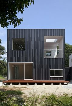 N House by TOFU~clad in tri-colored cedar panels in black and grays