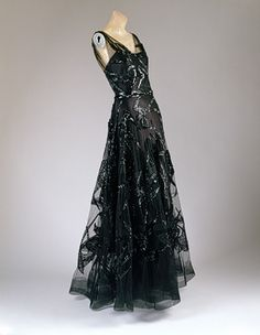 Evening dress, 1938  Madeleine Vionnet (French, 1876–1975)  Black silk satin and black silk net embroidered with black sequins