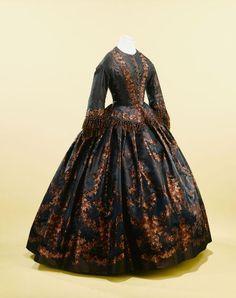 Figured Silk Day Dress, 1855  Burgundy silk gown with floral motifs.  Trimmed in silk fringe.    Palais Galliera, musée de la Mode de la Ville de Paris