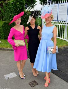 The skies may be grey and cloudy but revellers at the Ivestec Ladies Day brightened up the course at Epsom in a series of colourful frocks and fascinators