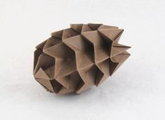 Pine Cone by David petty Diagrams in Origami: El Mundo Nuevo in Origami 1-2-3 and on David Petty's website Folded from a square of Kraft origami paper